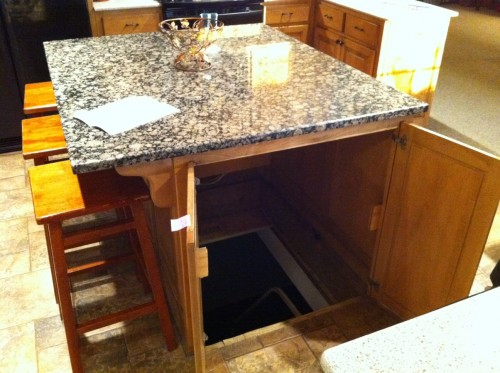 Kitchen Storm Shelter - Kitchen Island with trap door to underground storm/tornado shelter